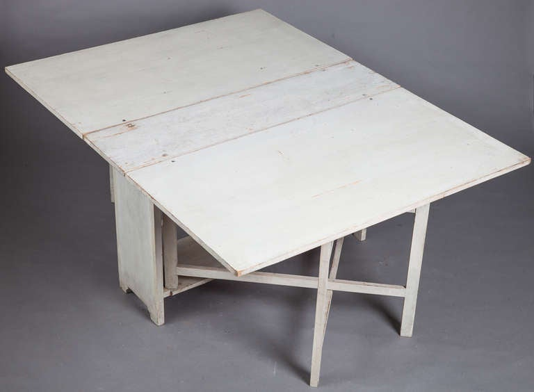 A Swedish drop leaf dining table circa 1840. image 4