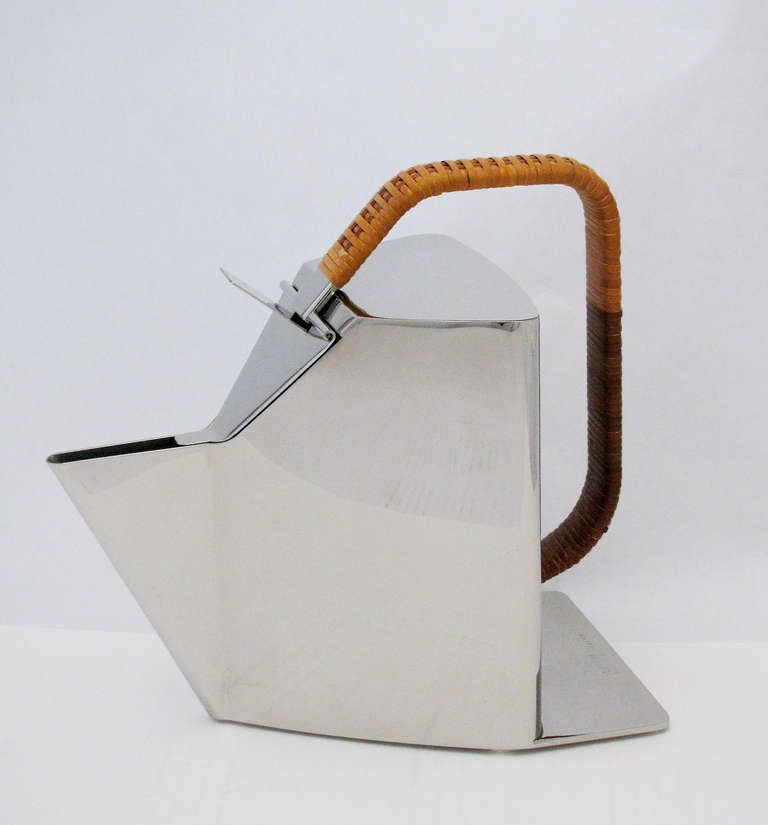 A rare polished steel kettle with cane-wrapped handle by Alessi, designed in 1987 by Richard Sapper. The Epitome of Modernism. Marked at base; Officina Alessi, Italy, model number 950120. No longer in production.