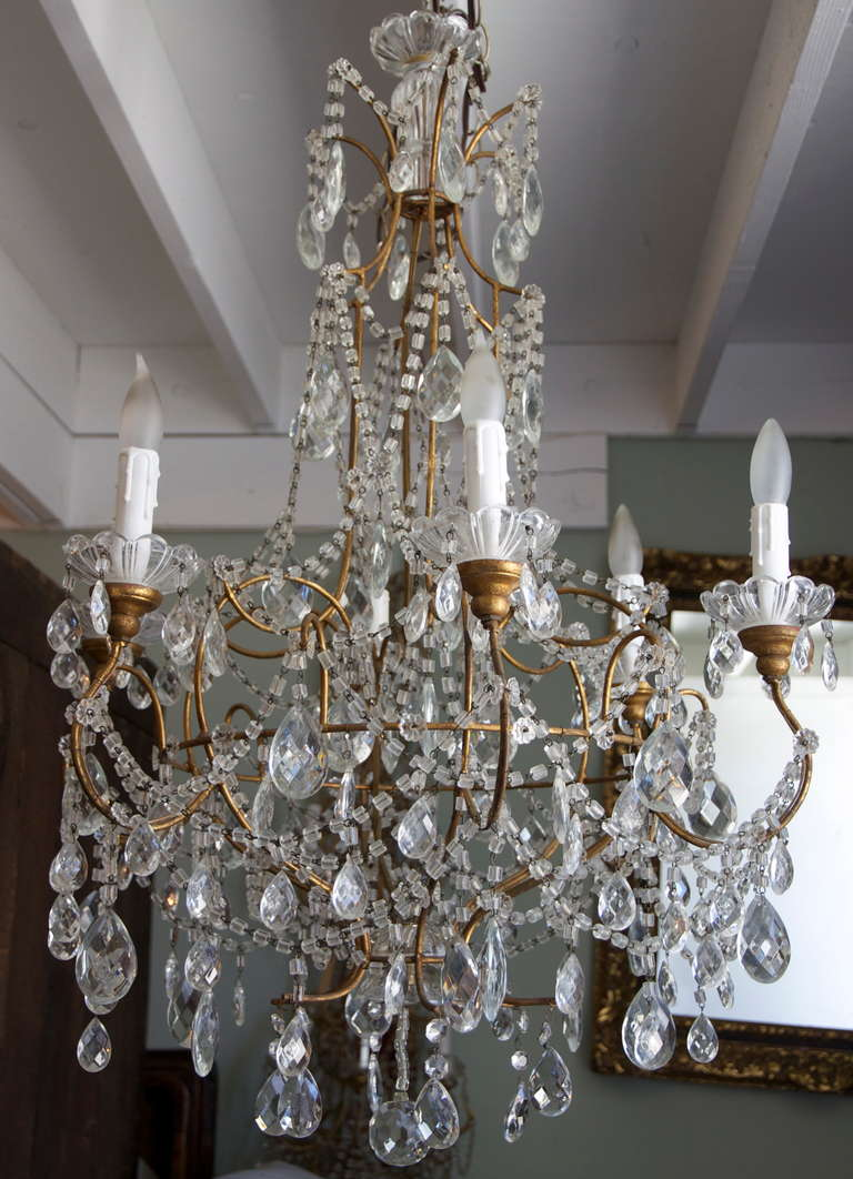 1930s italian crystal macaroni beaded chandelier at 1stdibs 1930s italian crystal macaroni beaded chandelier with metal arms and wooden bobeches newly wired with aloadofball Gallery