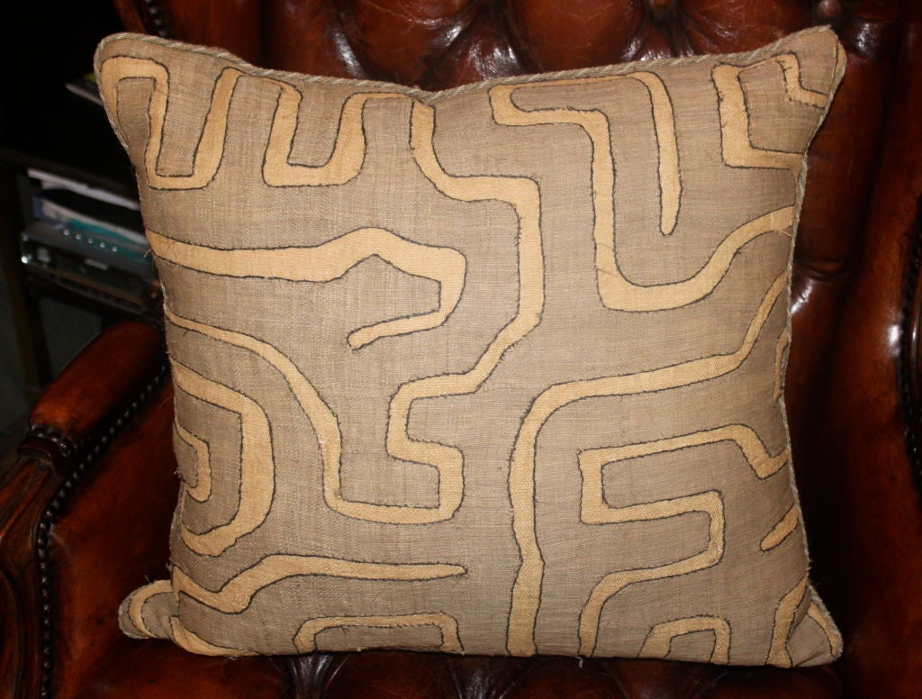 Pair of vintage African Kuba cloth pillows with high quality tweed fabric on the back and small contrasting cord around the perimeter of the pillows.  Down & feather inserts.