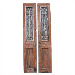 Pair of Antique Continental Carved Wood Doors with Iron Inset