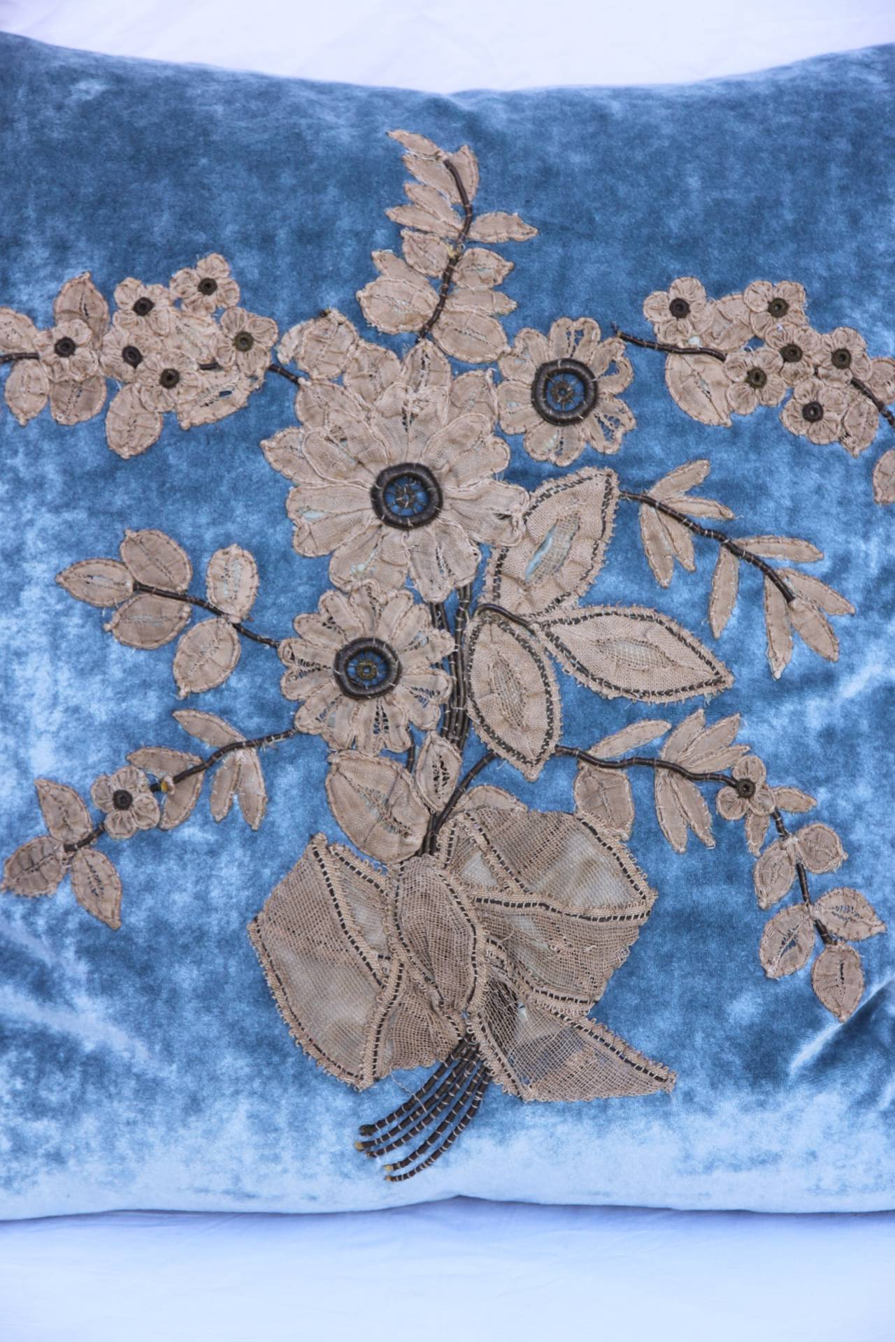19th century French metallic & lace appliquéd flowers on silk velvet background with linen back and silk tassel fringe at sides. Down filled insert.  Sewn shut.