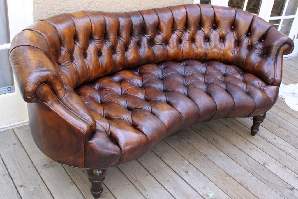 Merveilleux Leather Tufted French Petite Sofa With Curved Lines And Carved Feet.