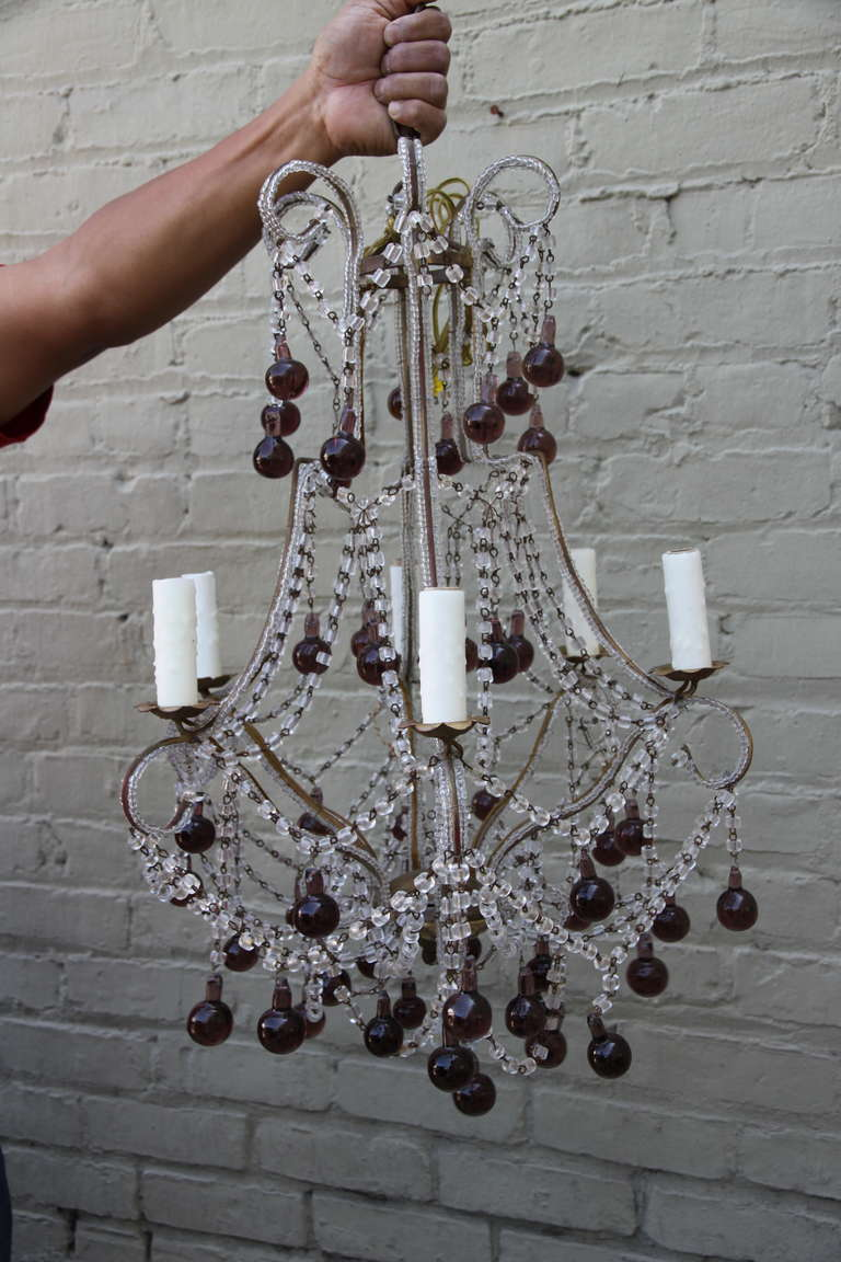 Italian macaroni crystal beaded six-light chandelier with amethyst colored drops.