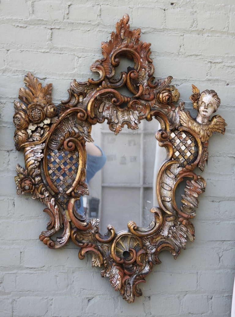 Pair of 19th century Italian giltwood Baroque style mirrors with cherubs.