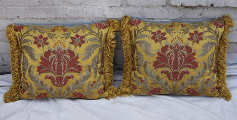 Pair of vintage silk Brocade silk pillows with linen backs and cotton fringe on sides. Down inserts. Sewn shut.