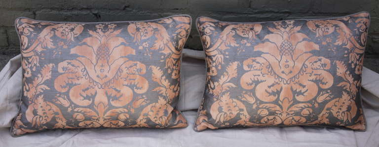 Pair of Italian faded peach & silver Fortuny textile pillows with linen back and self cording. Down insert. Sewn shut.