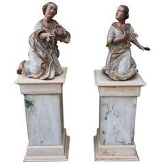Pair of 19th Century Carved Angels on Pedestals