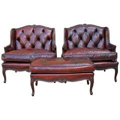 Pair of Leather Tufted Monumental Armchairs with Ottoman
