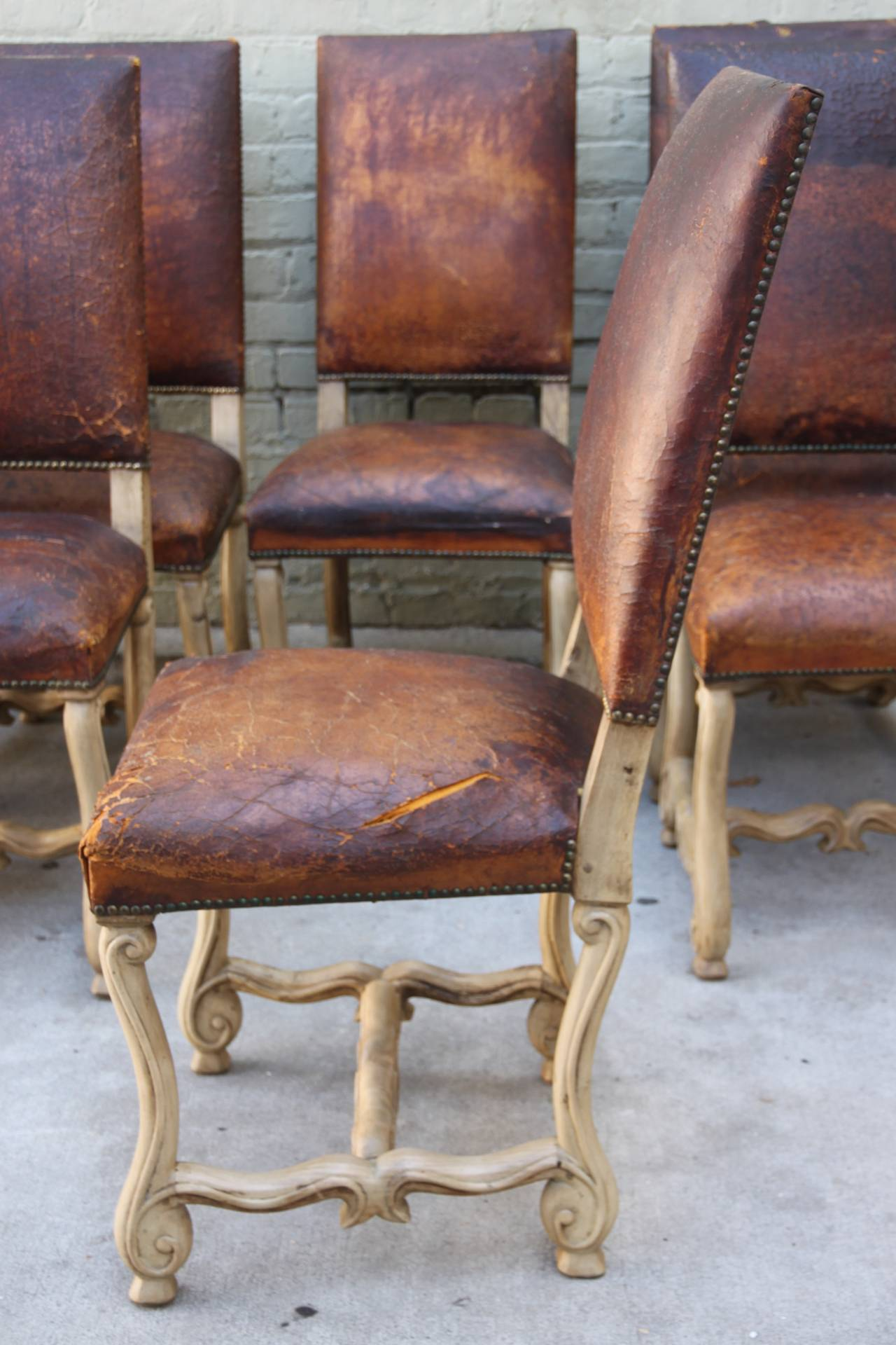 this set of eight spanish leather dining chairs is no longer available