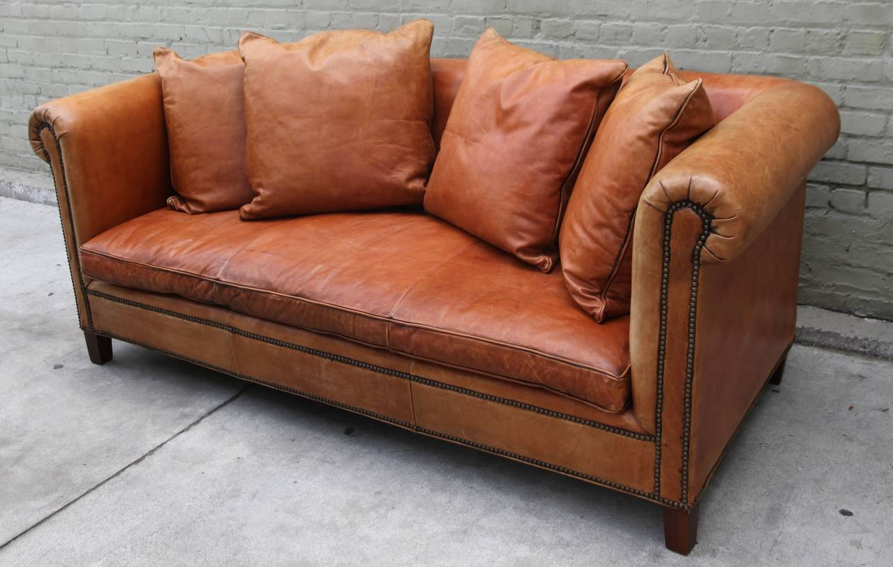 Vintage Ralph Lauren Leather Upholstered Sofa Standing On Four Wood Legs And Detailed With Nailheads
