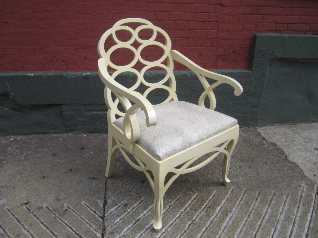 Faithful reproduction of Francis Elkins Loop chair from the 1940's.  This is a 1960's example with new upholstered seat in embossed faux shagrin leather.  Lacquer is a cream color.
