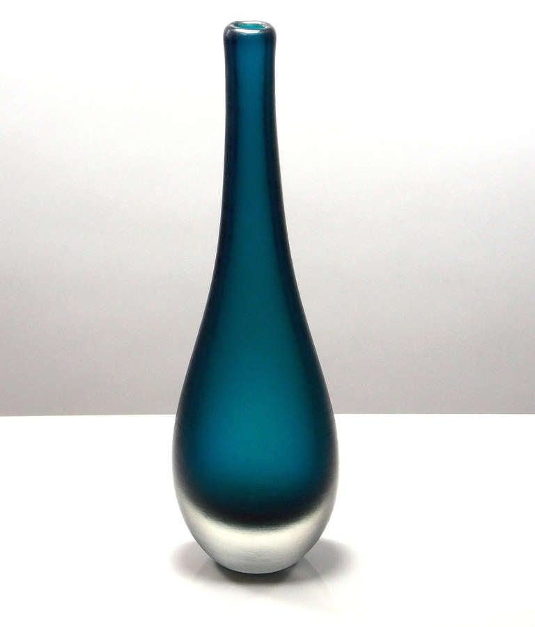 Inciso bottle-form vase in a subtle color.