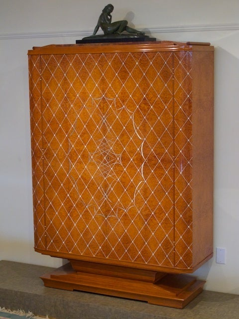 French 1940s cabinet by Pierre-Paul Montagnac. Model exhibited at the 1945 Salon d'Automne.  This cabinet is a masterpiece of French cabinet-making designed by Pierre-Paul Montagnac. The front is decorated in an intricate whiplash marquetry pattern.