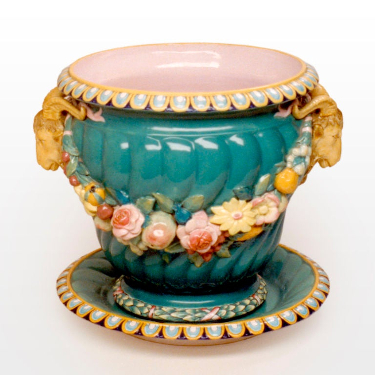 Majolica jardinière in rare green color with spiral fluted body, garlands of fruit and flowers, ram's head handles. Minton Renaissance piece like this one was shown at the Great Exhibition in 1851, modelled by Baron Carlo Marochetti. Known pattern