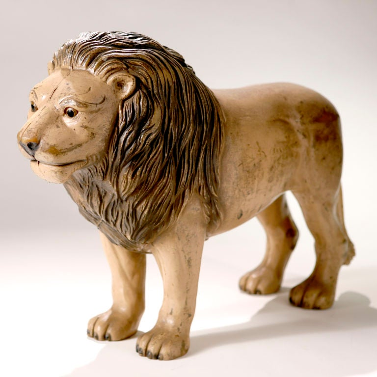 A rare early turn-of-the-century English nursery toy. A standing lion with warm smiling face and excellent detail. In hard molded rubber with the original