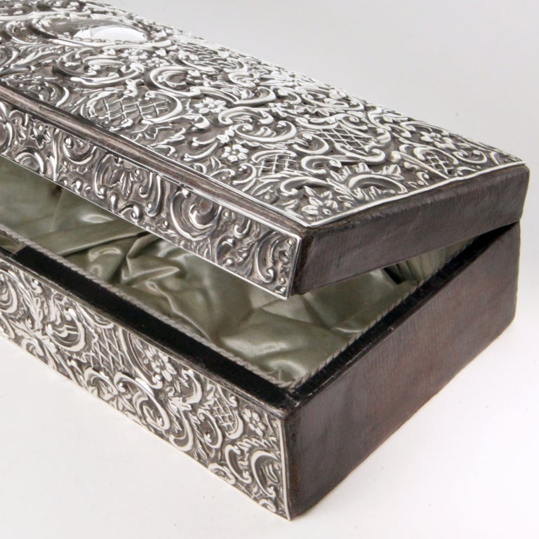 Finely crafted 19th century Victorian silver repousse desk box with swirl, flower and lattice pattern. Interior completely tufted in original pale green silk. Hallmarked H M.