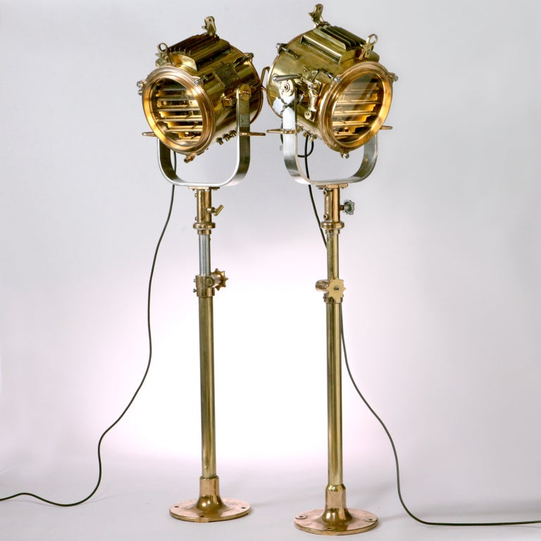 Exceptional pair of vintage English brass ships signal lamps well-known for being used by the British Royal Navy. These top quality lamps are in excellent condition with finely engineered details in polished brass, copper and steel. These 10 inch