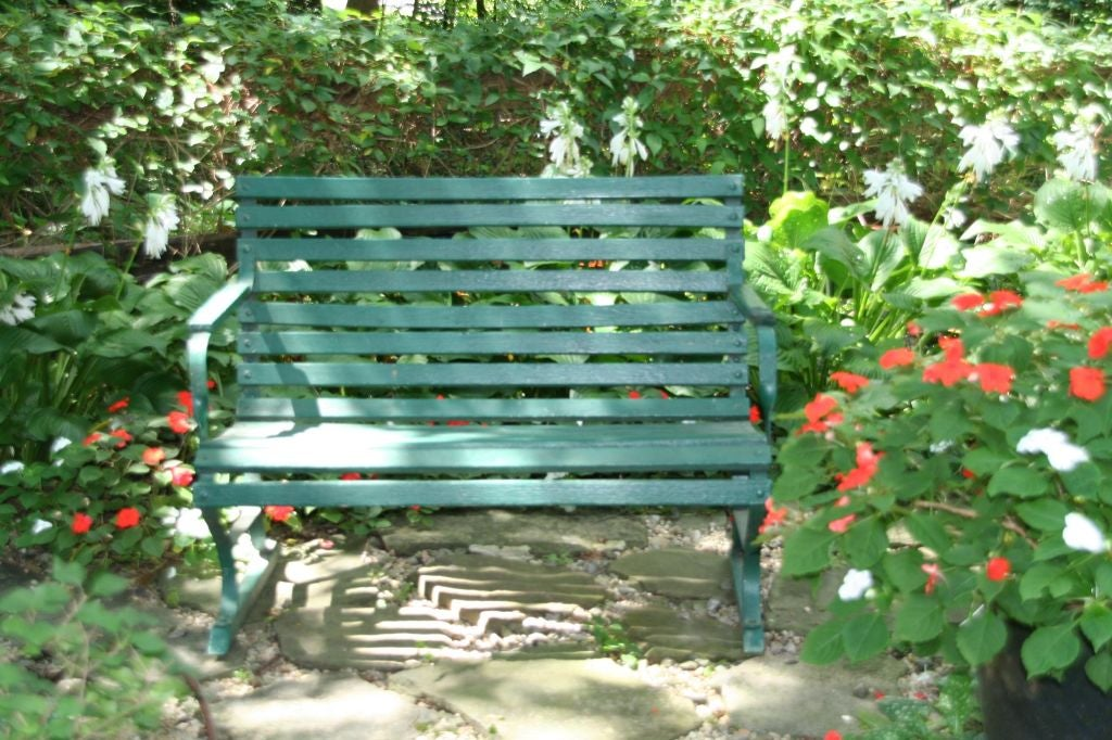 American garden bench, wood slats and iron supports. Painted in forest green.