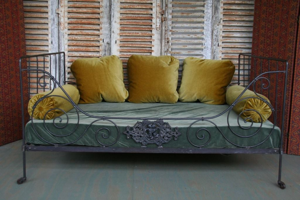 French iron bed, circa 1900, made to be used against the wall. This bed is not for sale, for rental only. Additional pillows and fabrics are available and may be included in the rental price.  Not for sale. For rental only.