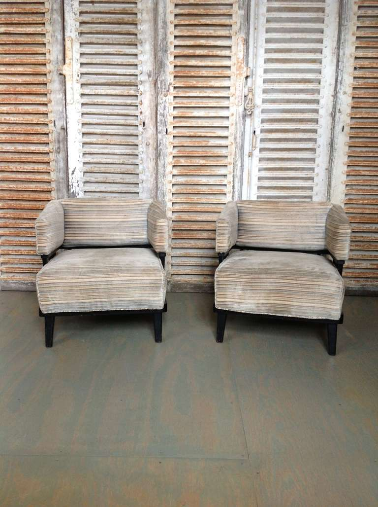 Pair of modern American armchairs with blue and tan striped fabric.