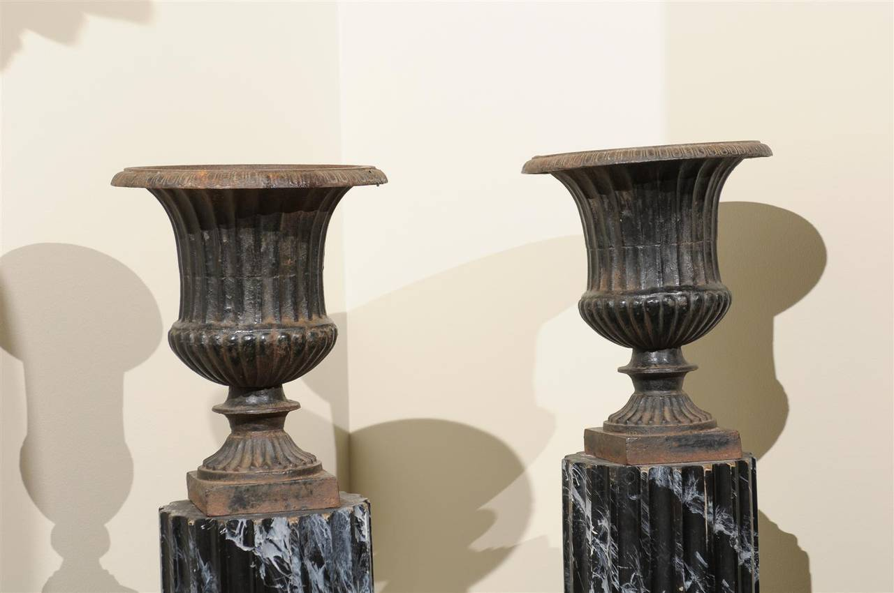 It is easy to see these urns are not the reproductions that are on the market today.  The finish is somewhat irregular with remnants of old rust and chipped places. We find the evidence of age appealing and interesting, just what we look for when we