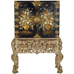 An Important William and Mary Japanned and Polychrome Decorated Cabinet