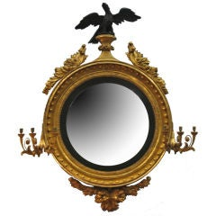 Regency Giltwood and Ebonized Convex Girandole Mirror