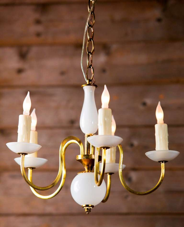 Beautiful Murano glass chandelier with brass arms.  Italian circa 1960s   Wired for the USA with candelabra sockets  Perfect for a powder room or little girl's room.