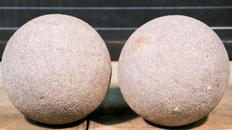 Pair of vintage hand carved decorative bluestone balls