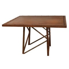 Industrial table with rivet detail