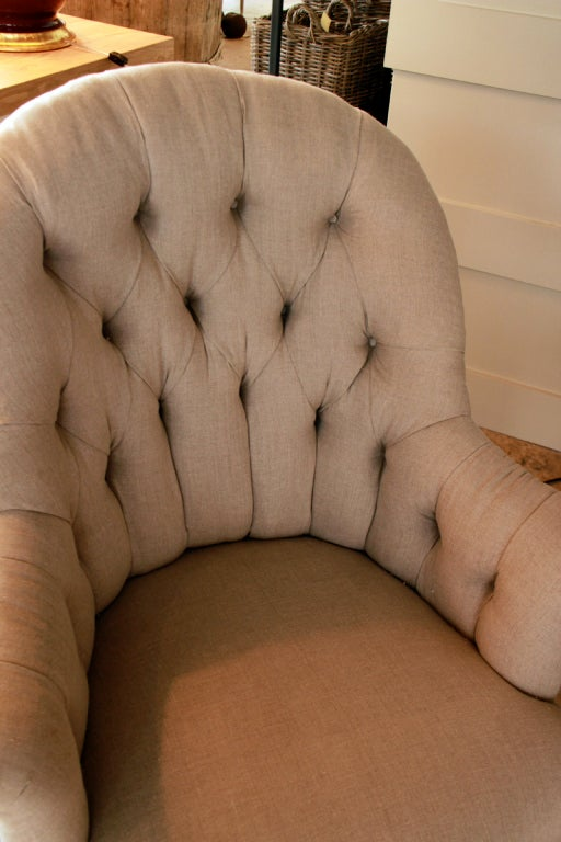 vintage French chair, newly upholstered and tufted in linen with tack detail