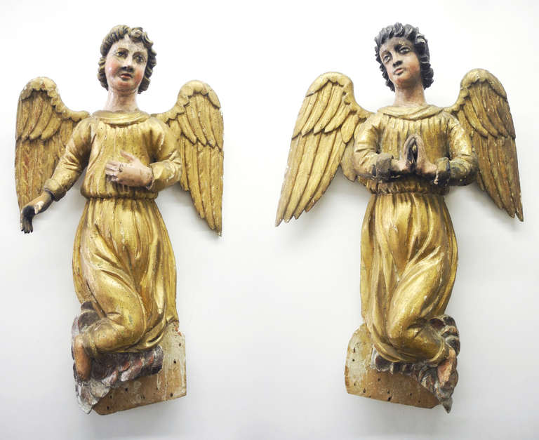 This is an special pair of early 18th century Italian Angels, most recently housed in a private chapel outside of Florence. They are in original condition, including their gold paint for their robes and wings, as well as skin and hair color. They