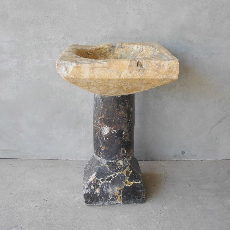 """This 16th century font (standing sink) was reclaimed from a Chateau in the Anjou Region of France, known as the """"Valley de la Loire."""" It is made of two type of marble fused together. The bottom is black marble with yellow veining while the"""