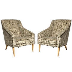 Pair of armchairs covered in snow leopard fabric, c. 1960