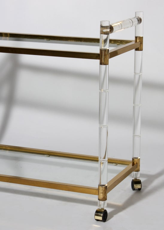 lucite bar cart with brass details and glass shelves c. Black Bedroom Furniture Sets. Home Design Ideas