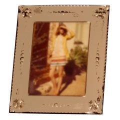 Pink mirrored frame with geometric beveling and floral etching