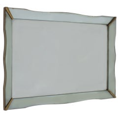 Mirror framed mirror with gold metal corners, c. 1940