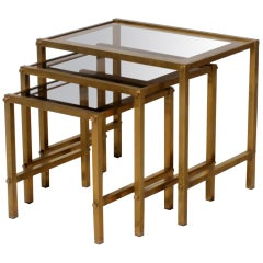 Nest of 3 bronze tables with glass tops, c.1950