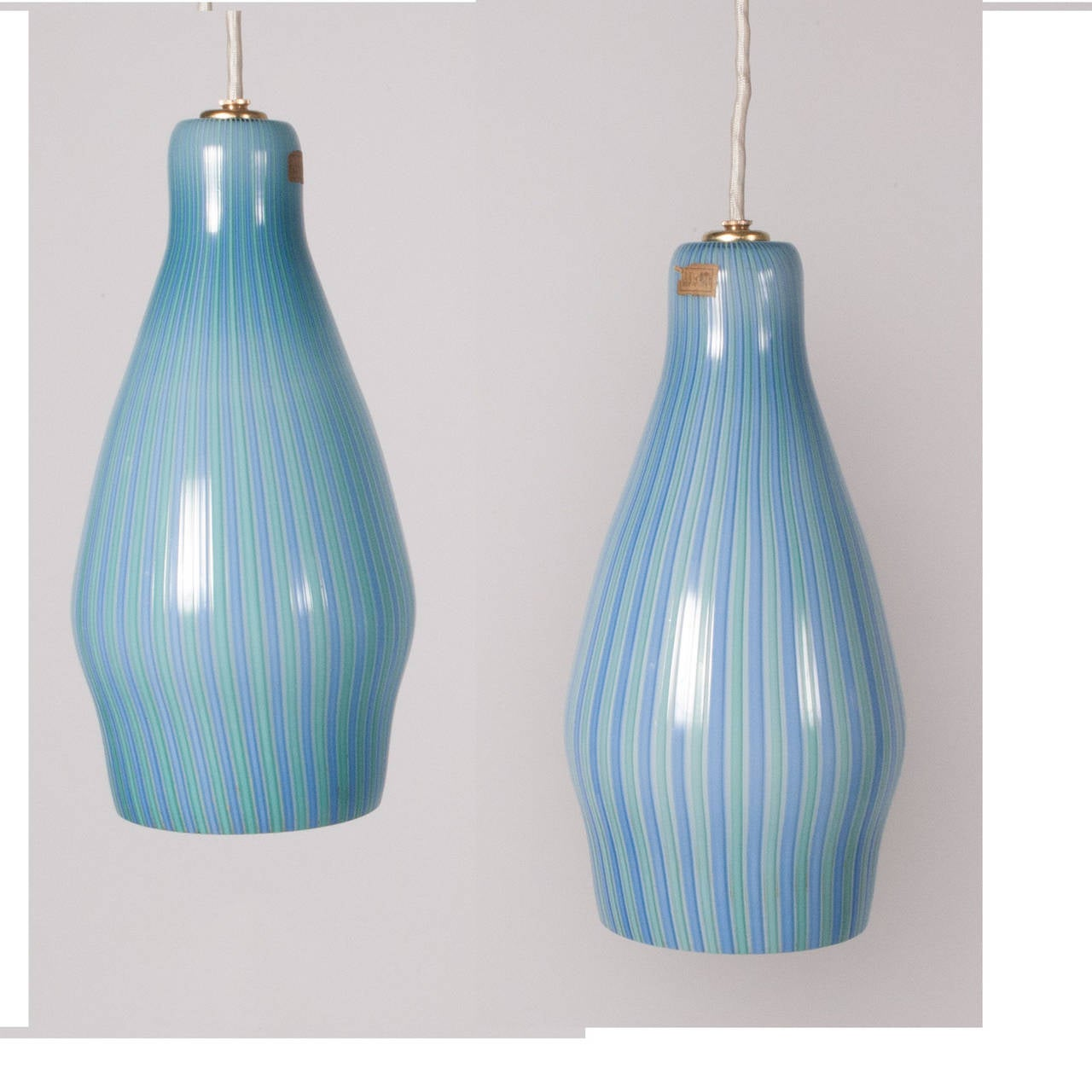 Lamps in blown glass streaked with milk-white and blue and light green rods, original paper stickers.
