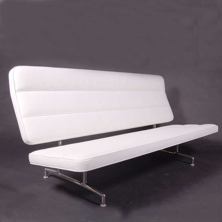 "Rare cast aluminium frame sofa, seat and angled back upholstered in new white leather. ""No-sag"" springs in seat. Channeled back and seat. Produced only from 1964-1973. Made by Herman Miller."