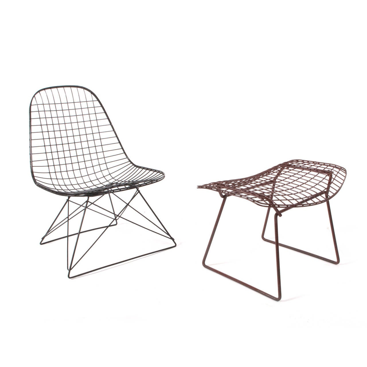 Black wire frame in original condition cage base wire lounge chair and original Harry Bertoia stool.