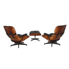 Pair of Charles Eames Rosewood Lounges and Ottoman