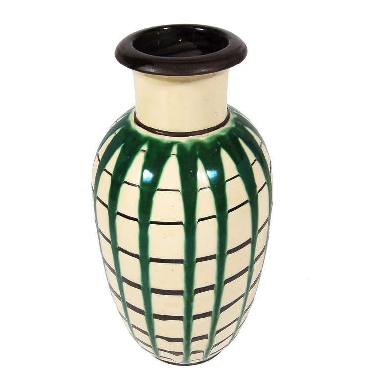 Hand thrown ceramic floor vase with hand-painted green and black striped glaze. Signed HAK, Denmark.