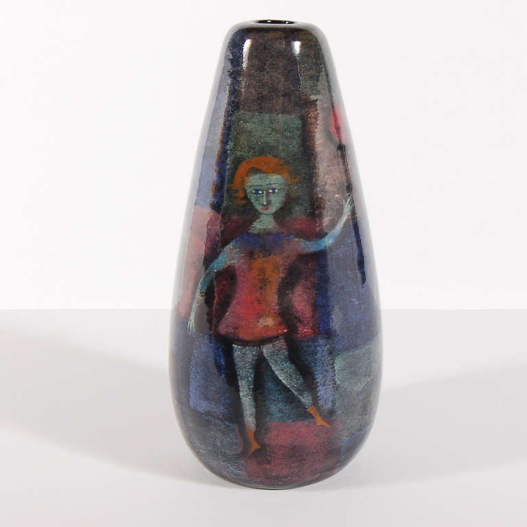 Painted and glazed ceramic vase with the figure of a woman on each side. Large size, vibrant colors. Signed on bottom.