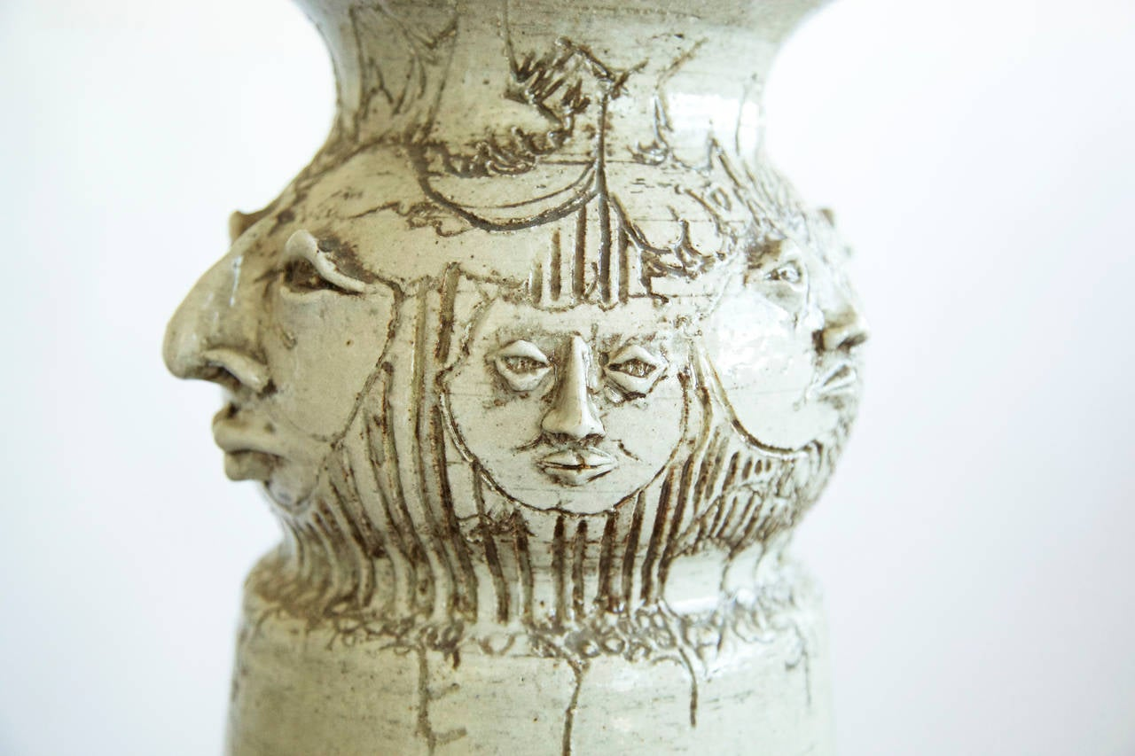 Clay Eight Faces Vase For Sale