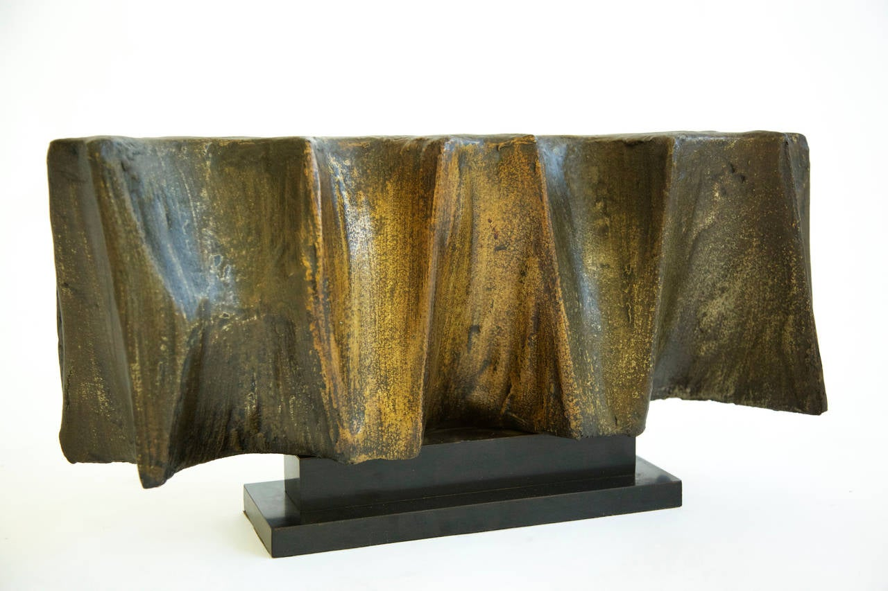 Evans Studio rare bronze resin sculpture. This sculpture executed in 1965 before the resin furniture line was introduced, when the studio was experimenting with resin applied materials. This sculpture is from an Evans employee from New Hope P.A. who