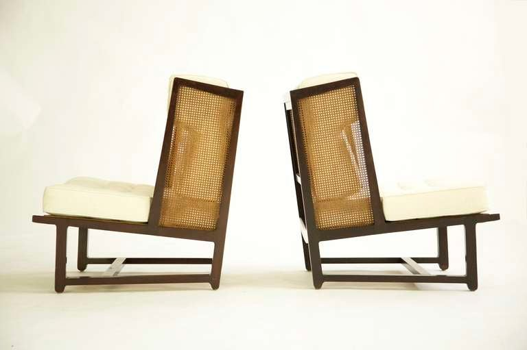 Edward Wormley for Dunbar, Rare pair of Snug Wingback Lounges. Model 6016 mahogany wood, caning and upholstery.