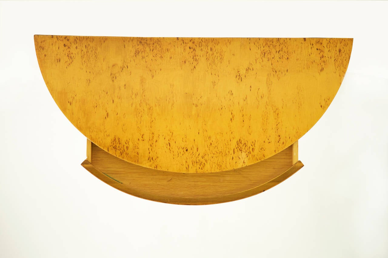A wall-mounted floating shelf with pull-out drawer, model No. 4903. Finished with a birch burl veneer. In the last image, a larger version, Model No. 4905 is displayed on the left of this shelf, also available separately.