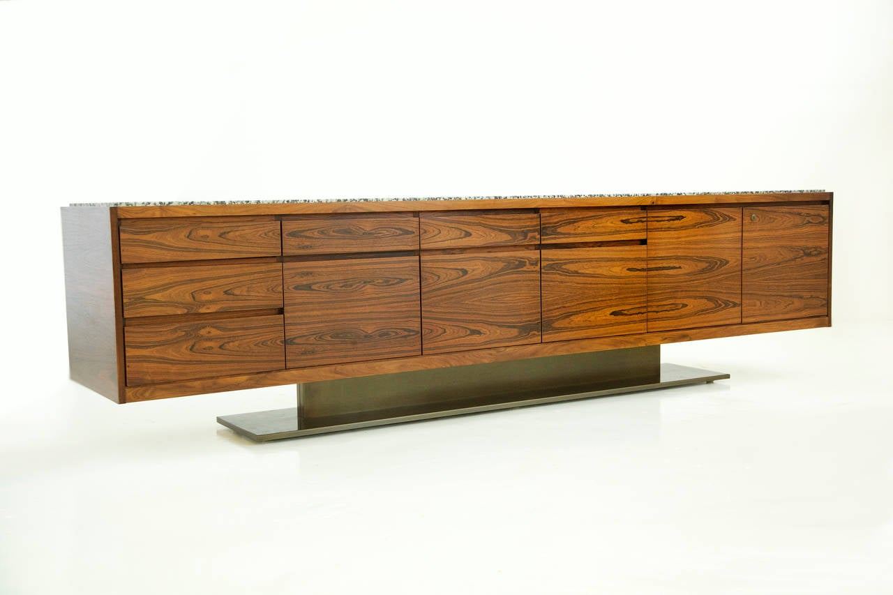 Exceptional monumental bookmatched highly figured rosewood veneer credenza by Platner for Lehigh Leopold. Composed of a three stacked drawer module, three file drawer modules with drawers above and double door section concealing three pull-out